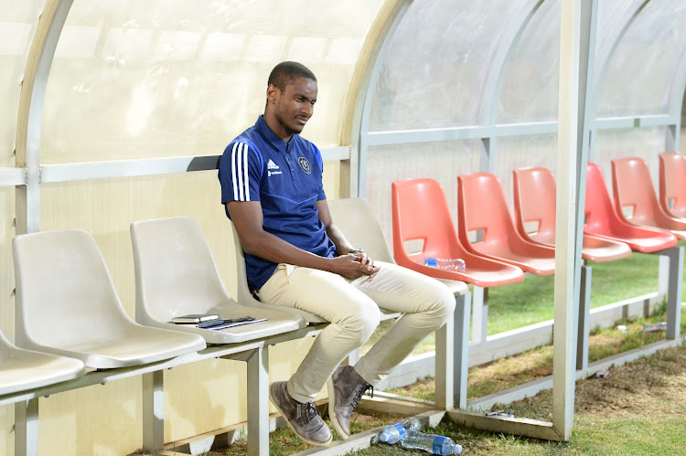 Orlando Pirates interim coach Rulani Mokwena, pictured here alone on the bench at Makhulong Stadium, was a relieved man after the final whistle in Tembisa.