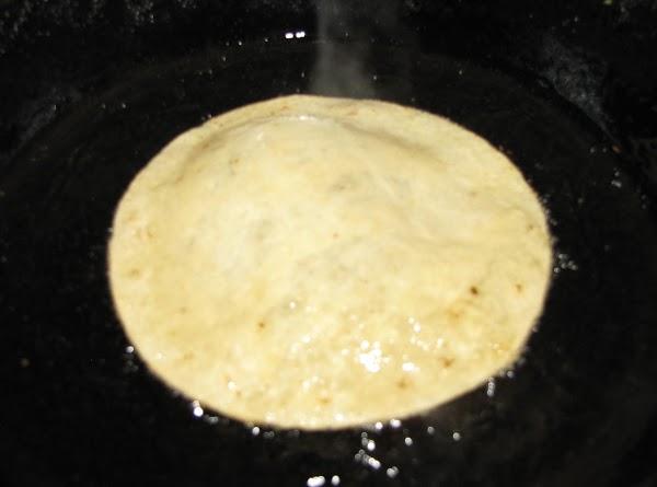 To soft fry tortillas: heat oil on medium high, insert one corn tortilla in...