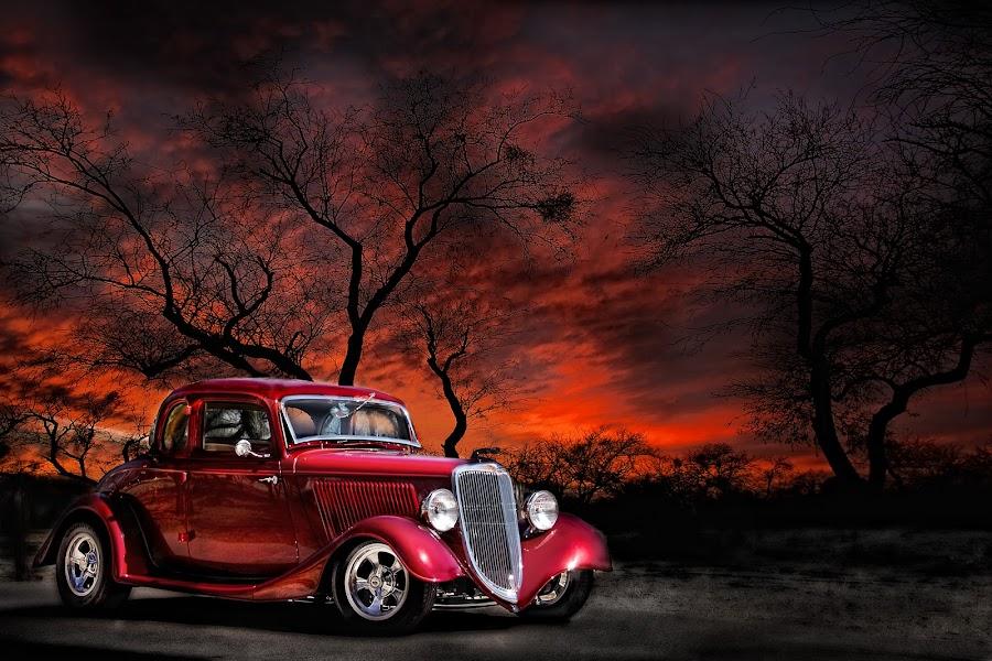 Old Timer by Juliet Newton - Transportation Automobiles ( automobiles, car, orange, 1934, vintage, automobile, chrome, vivid, transportation, landscape, stark, fire, red, sunset, trees, sunrise, ford )