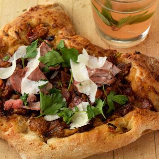 Pork Cassoulet Pizza with Shaved Tenderloin and Pecorino.