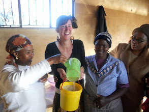Photo: Women in the community eagerly volunteer to help Hilsinger with her Peace Corps projects.