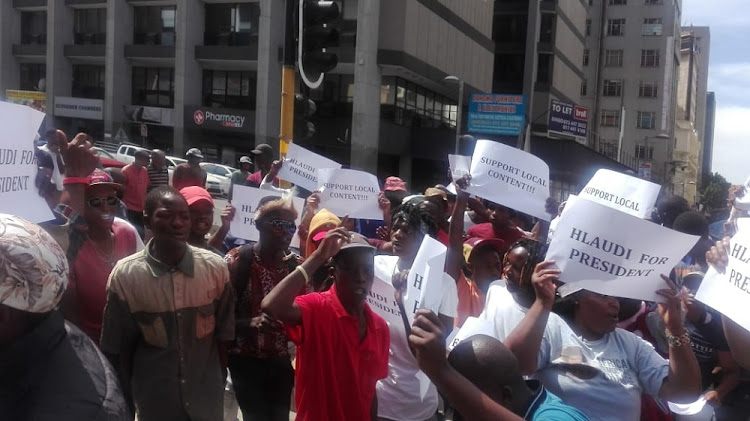 Supporters of former SABC Boss Hlaudi Motsoeneng singing and dancing outside the Gauteng High Court in Johannesburg.