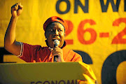 Following the formation of the EFF as a political party in July 2013, leader Julius Malema addresses the assembly at Uncle Tom's Community Centre in Soweto.