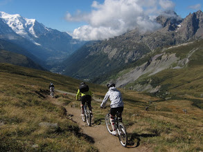 Photo: These cyclists have taken a chairlift all the way to the pass. They zoom down the trail as ...