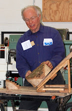Photo: Here Phil shows an angled band-saw jig to quickly remove waste wood from the bottom of a bowl blank, to save turning time, and...