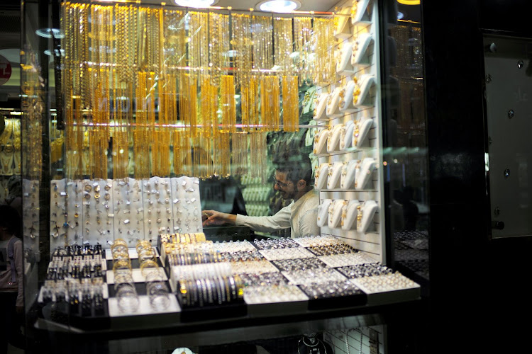A salesperson is seen at his gold shop in Gold Souq in Dubai, United Arab Emirates. Picture: REUTERS/HAMAD I MOHAMMED