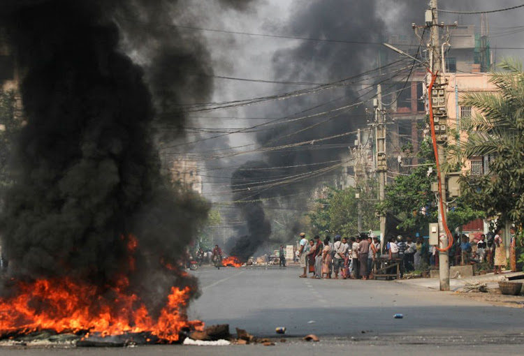 Tyres burn on a street as protests against the military coup continue, in Mandalay, Myanmar, on March 27 2021.
