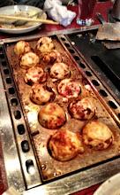 Photo: Cooking takoyaki