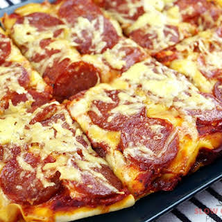 Incredibly Cheesy Slow Cooker Pizza.