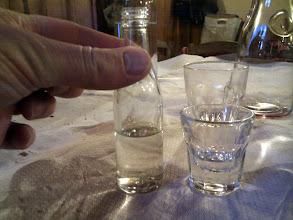 Photo: local cipuro served in miniature bottles