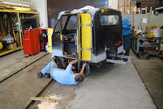 Photo: Bob working on the left door bottom latch.