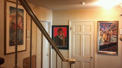 Photo: Satchmo '13 poster hangs between Jazz Fest posters of Jimmy Buffet and Allen Toussaint