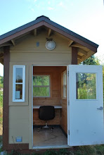 Photo: Mini park office complete with electrical wiring, insulated wall, floor and ceiling panels and fiberglass windows and doors.