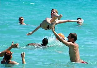 Photo: guy throwing woman in water. cuba. Tracey Eaton photo