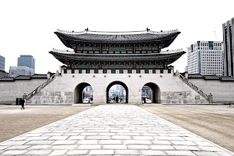 Photo: This is the western gate - Yongseongmum - set against the modern Korean high rise buildings.