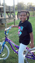 Photo: Kaleya rides her bike at the park
