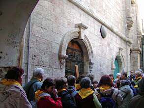 Photo: Pilgrims walk the Way of the Cross on the Via Dolorosa. This is the sixth Station-Veronica wipes the face of Jesus.
