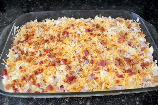 Remove casserole from refrigerator; temporarily remove foil; scatter finely crumbled bacon over top.