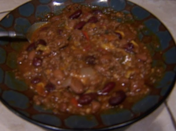 Remove whole chili peppers.Serve over rice with shredded cheddar cheese.