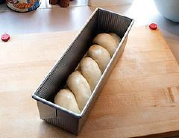 Divide the dough into two equal pieces. Form each piece into a log that...