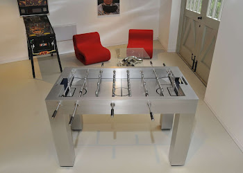 The Kicker Football Table in Gamesroom  in front of an arcade and red chairs