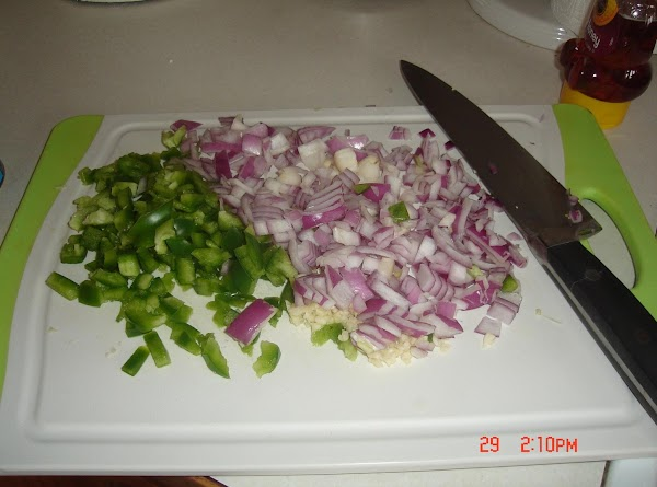 In a large bowl, whisk together oil, lime juice, chili powders, cumin, salt and...