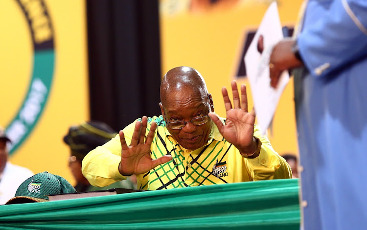 ANC President Jacob Zuma gestures to the media before addressing delegates at the 54th ANC National Conference taking place in Nasrec.