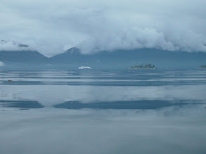 Photo: An Alaska Ferry heads north up Stephens Passage past Midway Island.