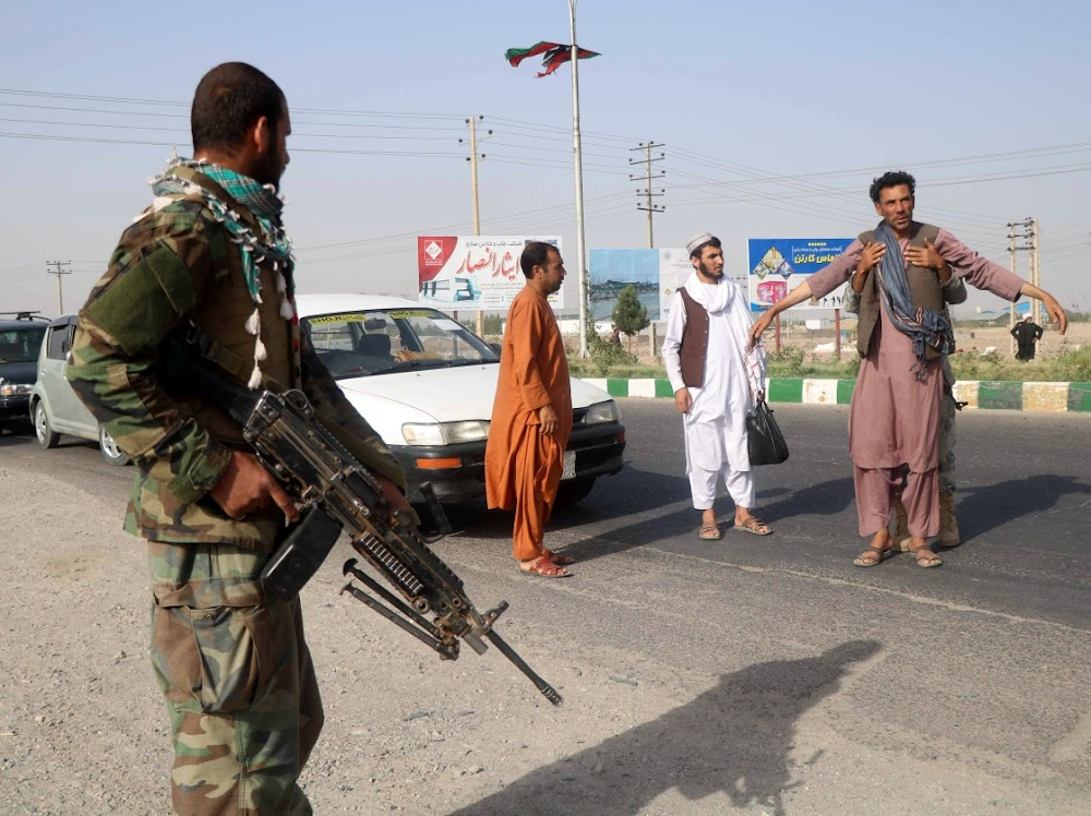 Militia commanders rush to aid Afghan forces against Taliban