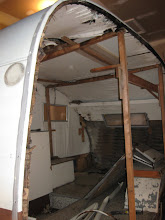 Photo: Left side wall came off with the aluminum (what was left of it)  the supports is all that was holding up the roof.