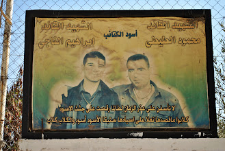 Photo: An old, faded picture of two Palestinian martyrs from the Intifada years in Nablus, West Bank. (SOLD)