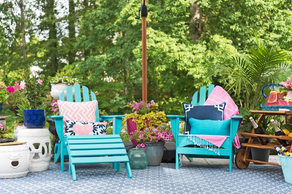 brightly colored Adirondack chairs on blue patio