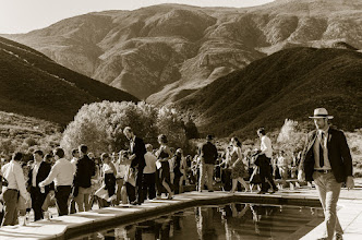 Photo: Ceremony up  at the pool with the mountains as the backdrop