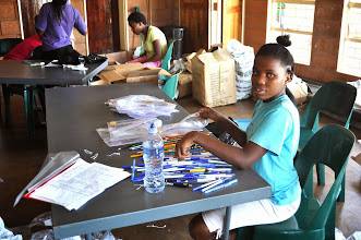 Photo: Assembling the school packs for the visitors.
