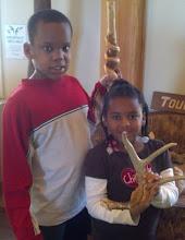 Photo: Q & Kaleya hold bones