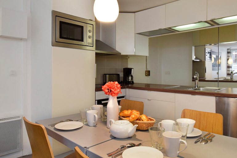 Luxury dining space at Marais & Palais Royal Serviced Apartment, Opera