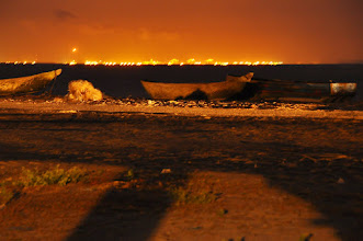 Photo: oil fires in Angola behind the Congo River