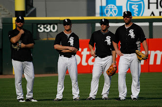 Photo: Chicago White Sox players from left, A.J. Pierzynski, Gordon Beckham, Brent Morel, Adam Dunn, before a baseball game between the Chicago White Sox and the Detroit Tigers Friday, June 3, 2011 in Chicago. (AP Photo/Charles Rex Arbogast)