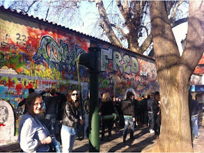 Photo: John Lennon Wall. Wall At March 2012.  The wall continuously undergoes change and the original portrait of Lennon is long lost under layers of new paint. Even when the wall was repainted by some authorities, on the second day it was again full of poems and flowers. Today, the wall represents a symbol of youth ideals such as love and peace.
