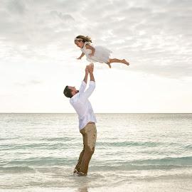 The Groom and his daughter by Andrew Morgan - Wedding Other ( flying, zanzibar, wedding, seaside, flower girl, island )