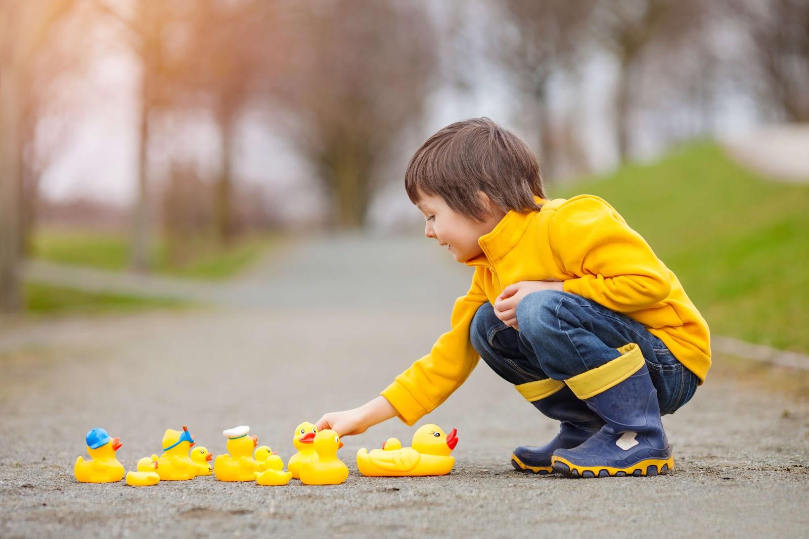 Child practicing debugging code with rubber ducks