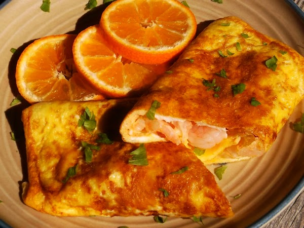 Remove from heat. Slide omelette onto warm serving plate; garnish as desired. Serve hot.