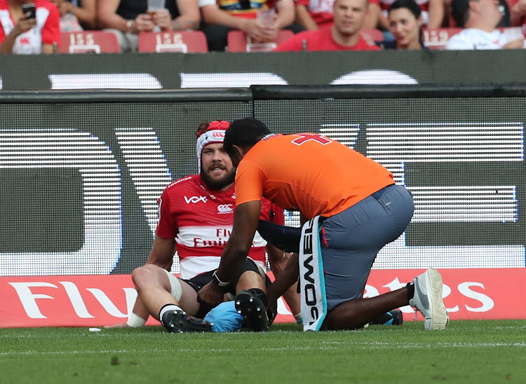 The Emirates Lions captain Warren Whiteley being treated on the field after sustaining an injury during the Super Rugby match against the Blues at Ellis Park, Johannesburg on 10 March 2018.