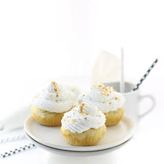 Vanilla Cupcakes with Coconut Cream Frosting.