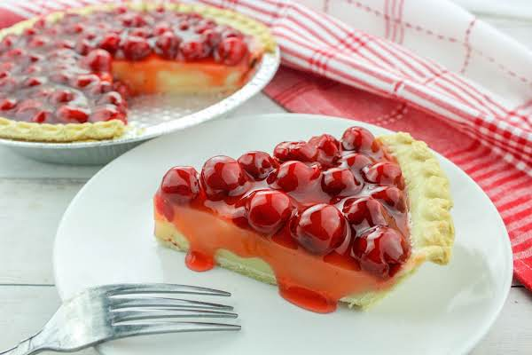 A Slice Of Cherry Cream Pie On A Plate.