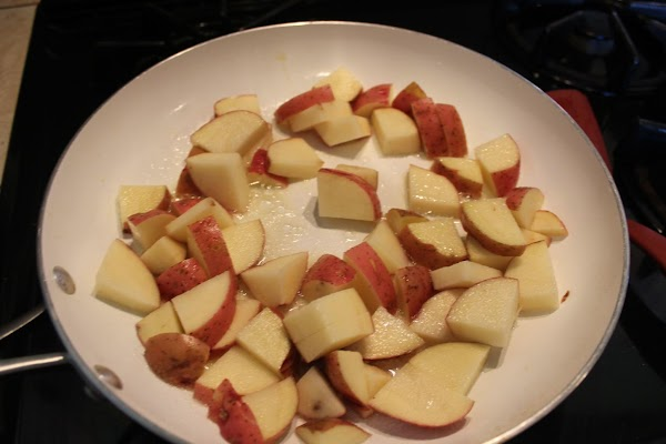Add the potatoes & sprinkle with some salt. Cook for a couple minutes, tossing...