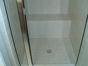 Photo: shower surround tiled with wall tiles