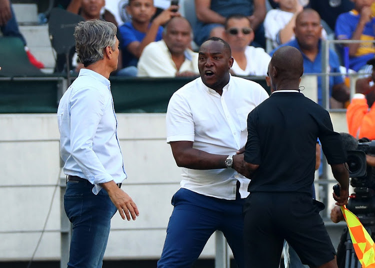 Benni McCarthy, head coach of Cape Town City reacts in anger at Muhsin Ertugral, Coach of Ajax Cape Town during the Absa Premiership 2017/18 football match between Cape Town City FC and Ajax Cape Town at Cape Town Stadium, Cape Town on 20 January 2018.