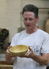 Photo: Duane Schmidt shows an Osage orange bowl.