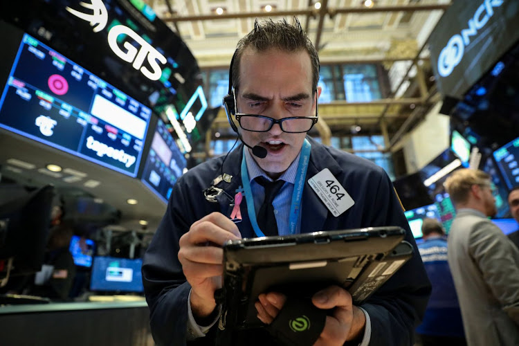 Traders work on the floor of the New York Stock Exchange on November 7 2018. Picture: REUTERS/BRENDAN MCDERMID